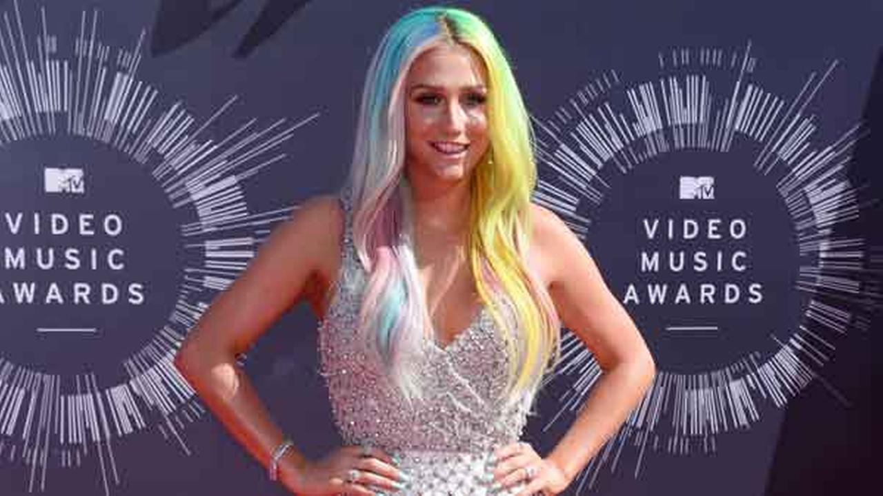 FILE - In this Ag. 24, 2014 file photo, Kesha arrives at the MTV Video Music Awards at The Forum in Inglewood, Calif.