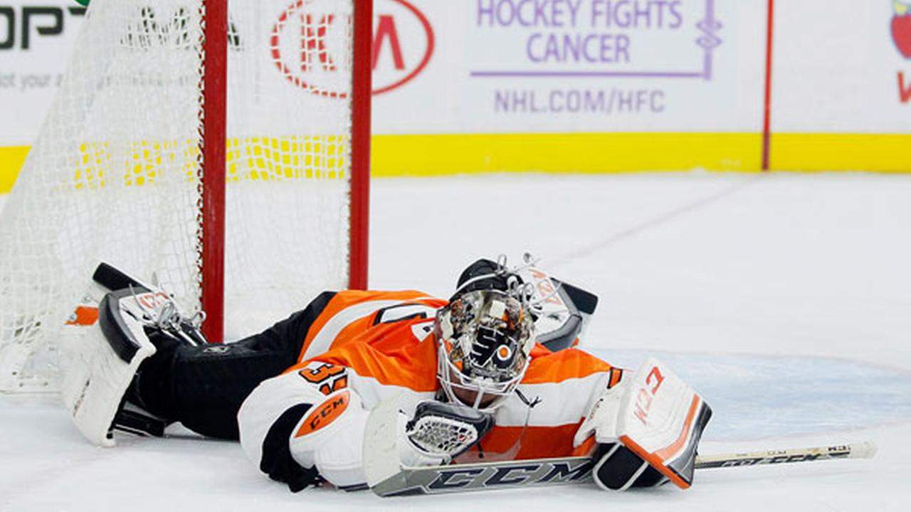The Philadelphia Flyers goalie Steve Mason (35) sprawls on the ice after failing to stop a shot by the Anaheim Ducks Tim Jackman during the first period of an NHL hockey game.