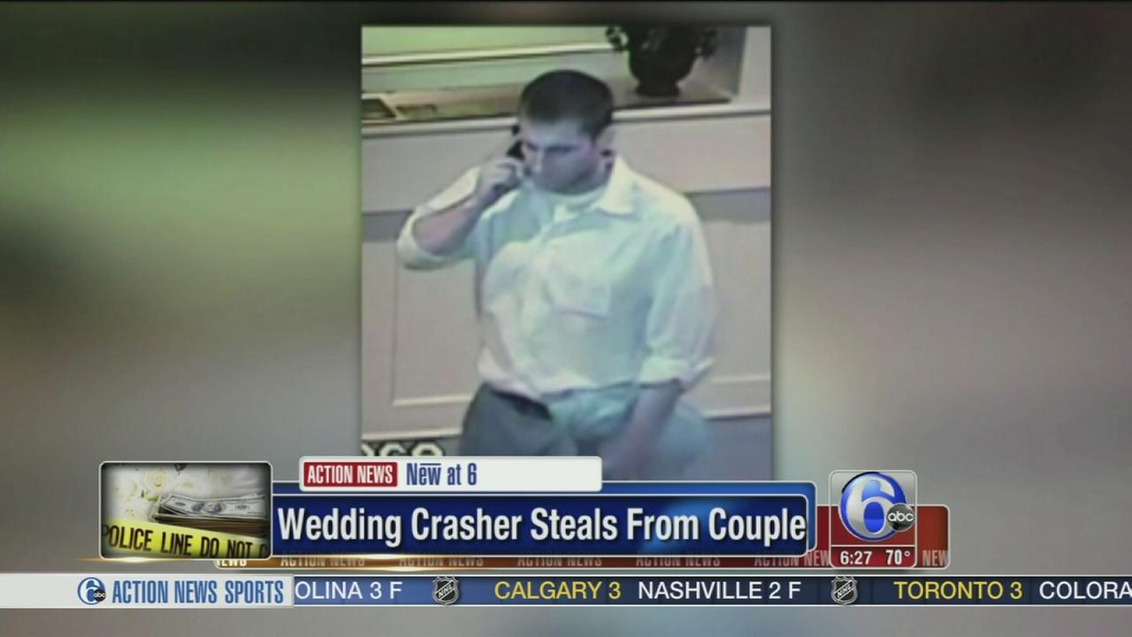 VIDEO: Wedding crasher steals couples gifts