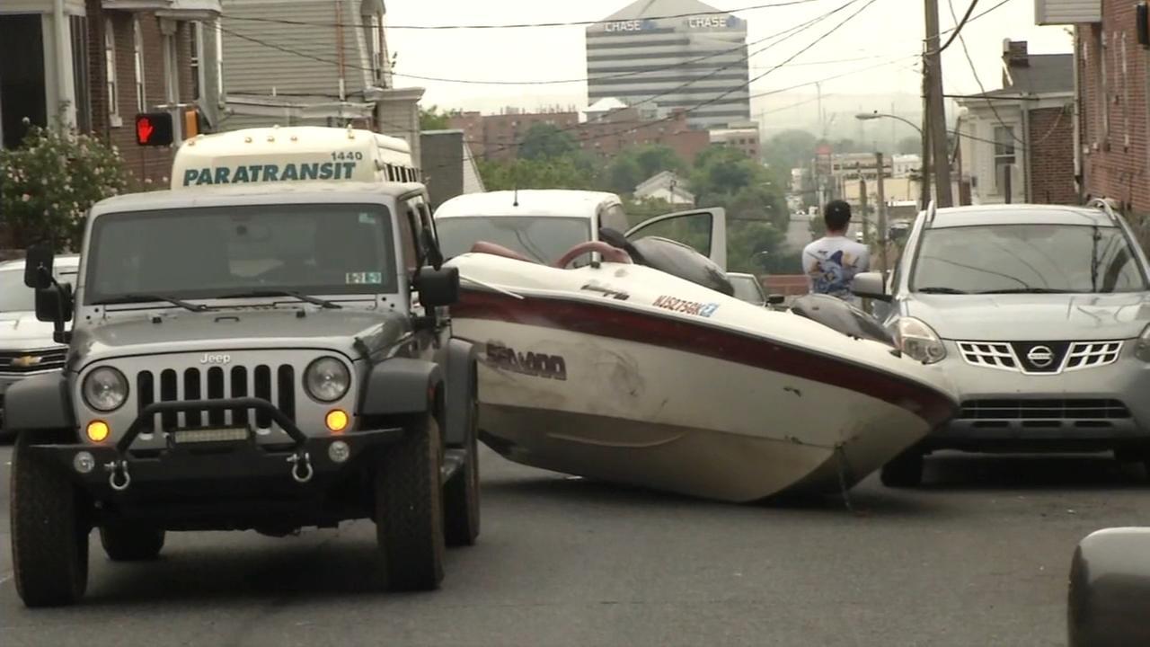Boat flies off trailer after crash