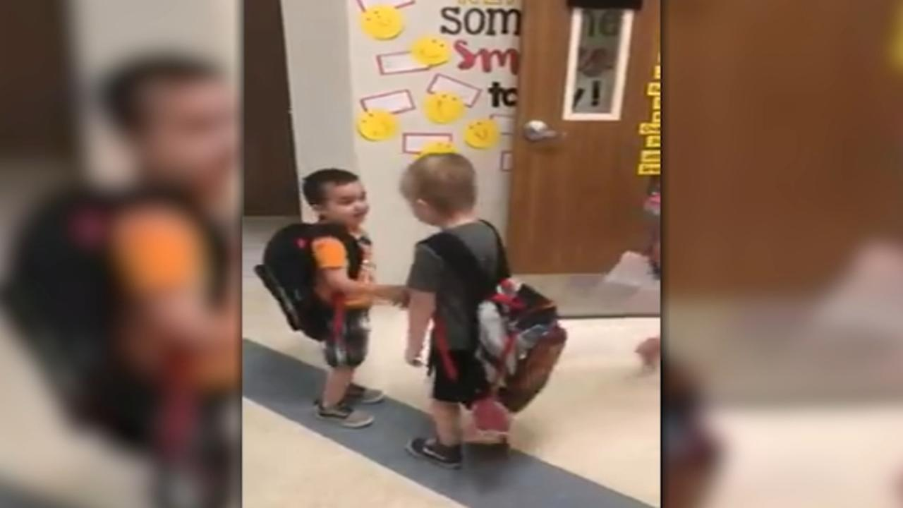 Kindergarten class starts day with handshakes