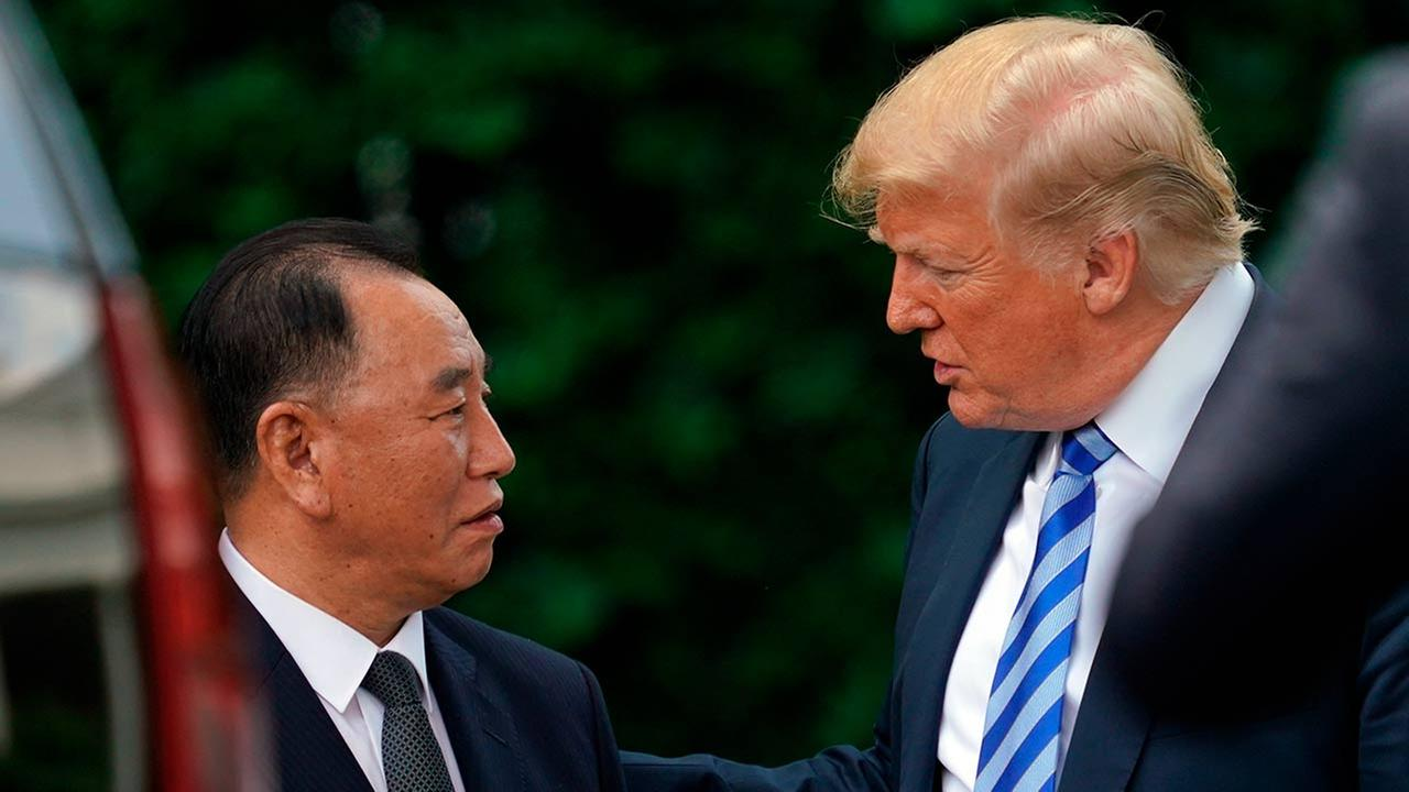 President Donald Trump talks with Kim Yong Chol, left, former North Korean military intelligence chief and one of leader Kim Jong Uns closest aides, Friday, June 1, 2018.