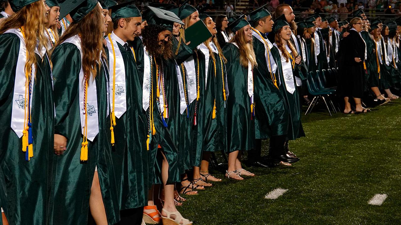 More than 300 seniors at a Texas high school have received their diplomas with the memory of a deadly mass shooting on campus still fresh in their minds.