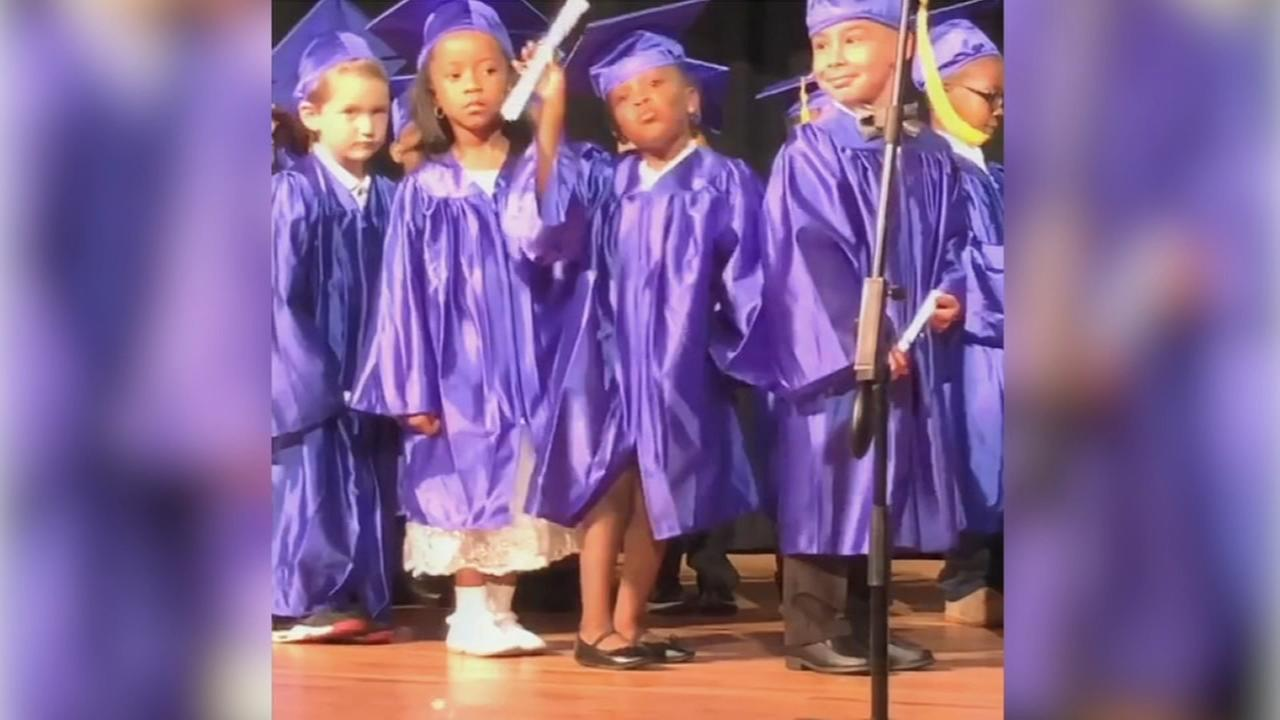 Dancing girl steals show at pre-K graduation