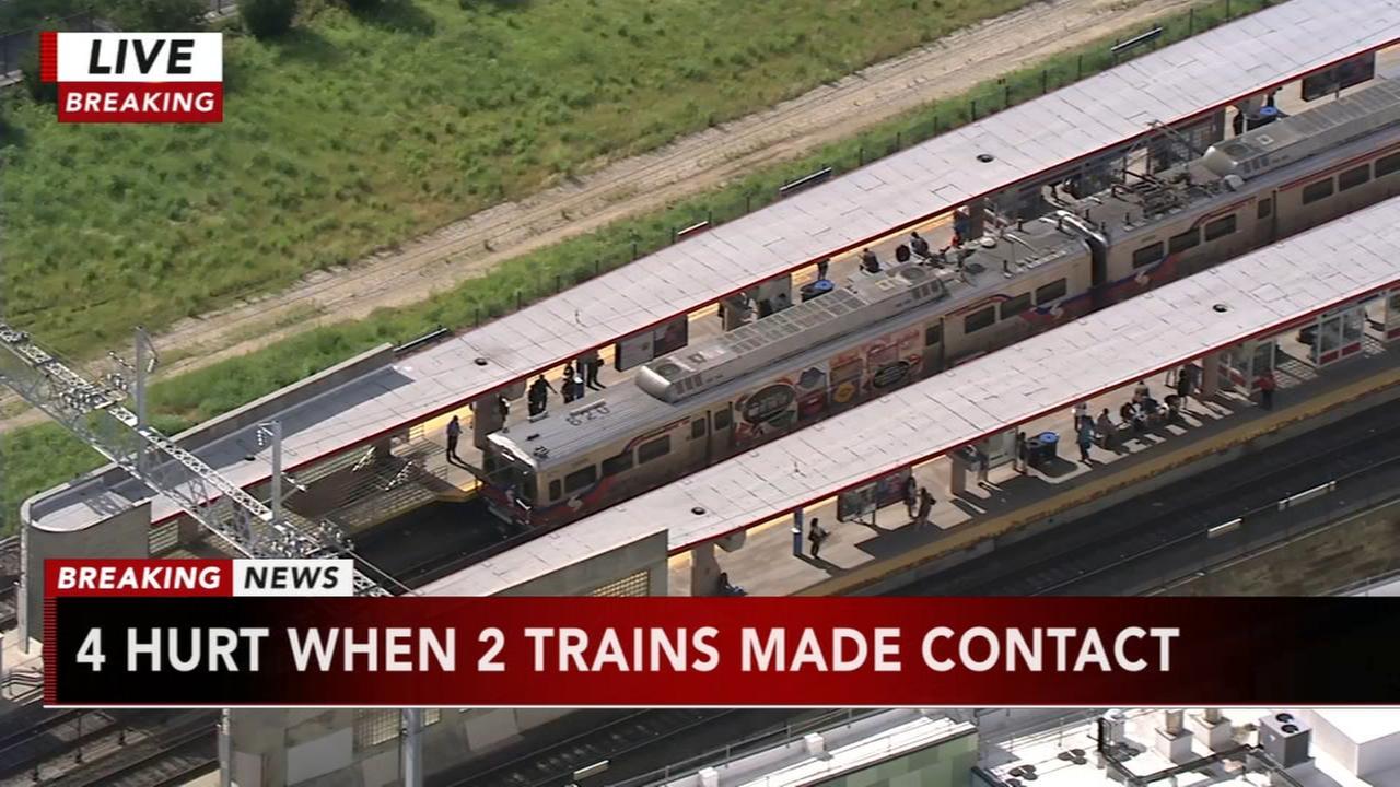 4 hurt when 2 trains make contact