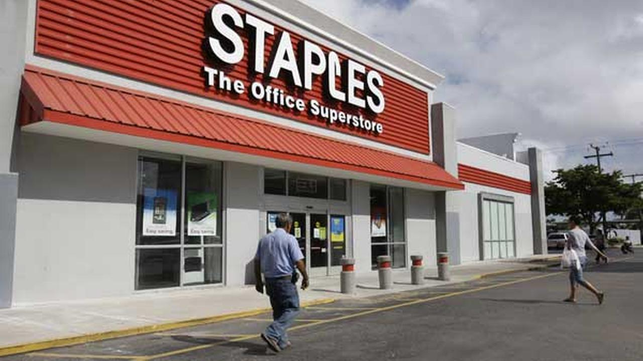 FILE-This Tuesday, Nov. 15, 2011, file photo, shows a Staples office supply store in Miami.