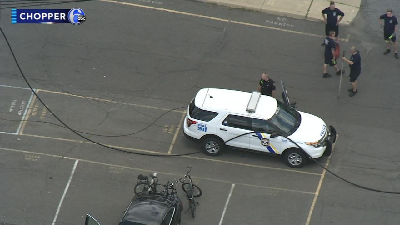 Philadelphia police officer escapes after live wire falls on police SUV