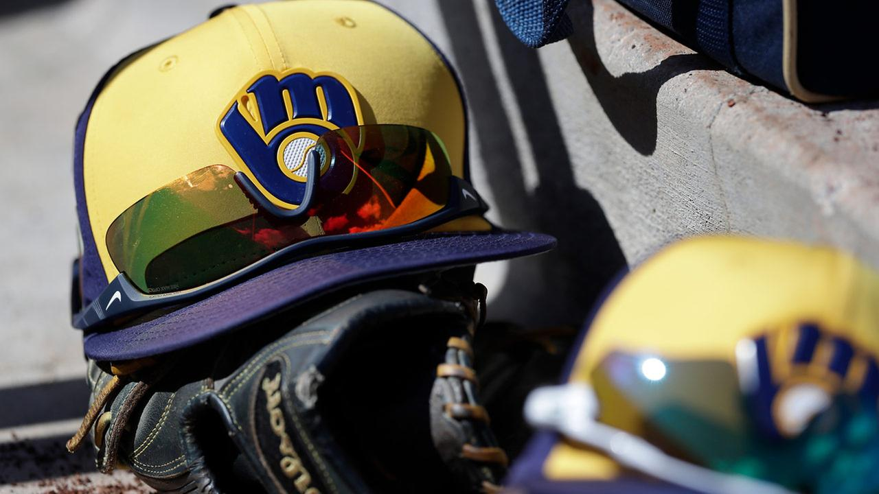 FILE: Two Milwaukee Brewers caps are seen in the dugout during the second inning of a spring training baseball game against the San Francisco Giants, Wednesday, Feb. 28, 2018.