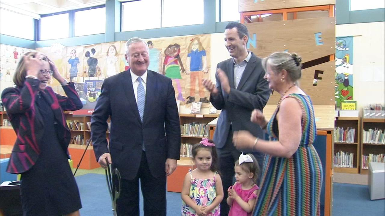 Mayor Jim Kenney unveils a new section of a local library.