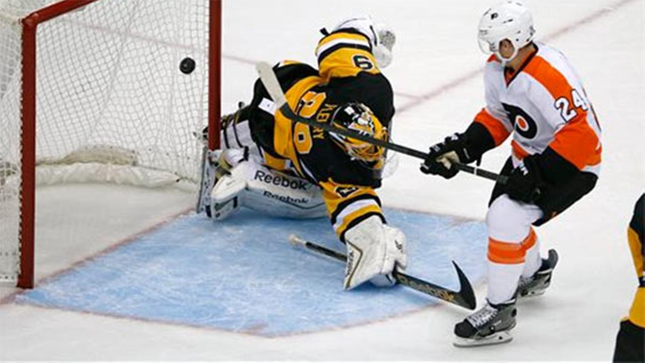 Philadelphia Flyers Matt Read (24) backhands a shot over Pittsburgh Penguins goalie Marc-Andre Fleury (29) for a goal, Wednesday, Oct. 22, 2014.