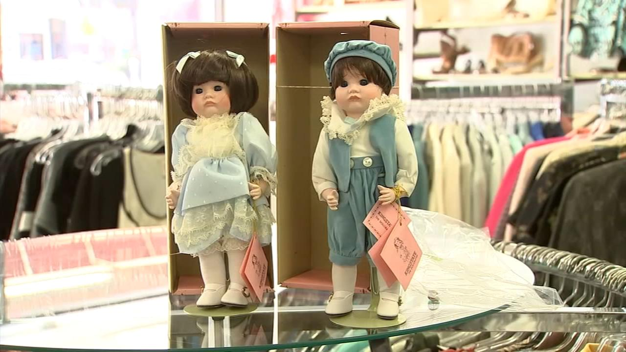 Thrift shop alerts couple of money in doll box