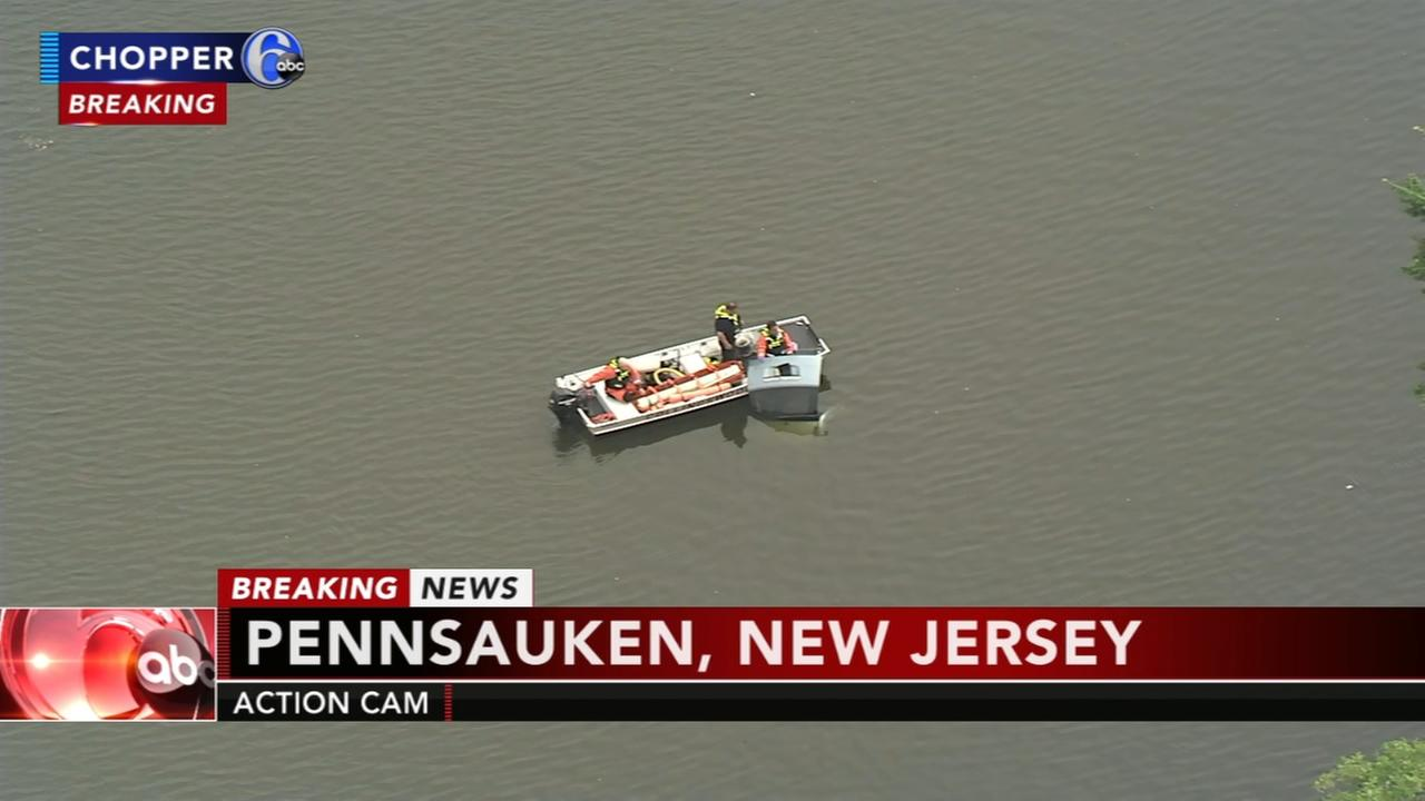 Vehicle plunges into Cooper River