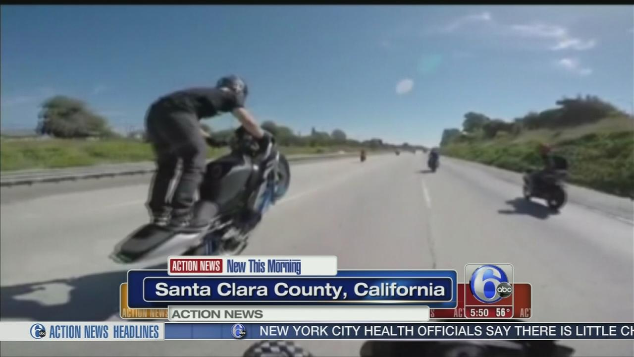 VIDEO:  Bikers pop wheelies while speeding from police