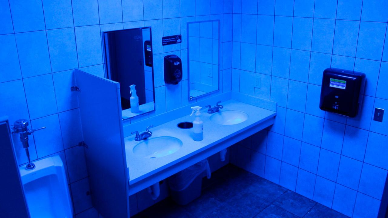 In this June 22, 2018 photo, a public bathroom bathed in blue light is seen at this Turkey Hill convenience store in Wilkes-Barre, Pa.
