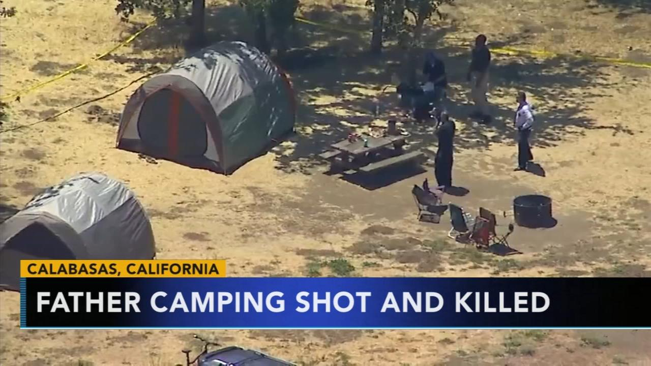 Father camping shot and killed