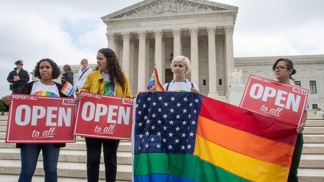 In this June 4, 2018 photo, American Civil Liberties Union activists demonstrate in front of the Supreme Court in Washington.