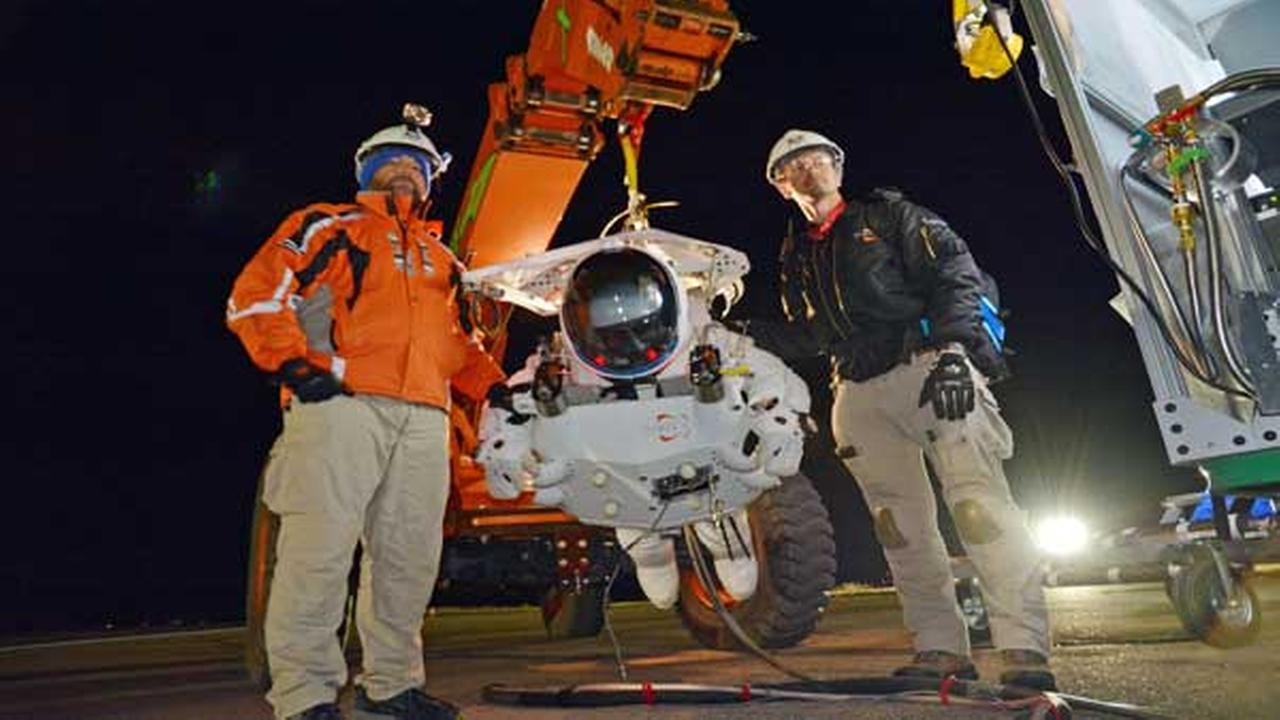 Google executive Alan Eustace is shown with crew members before his leap from the edge of space that broke the sound barrier and set several skydiving records Friday, Oct. 24, 2014