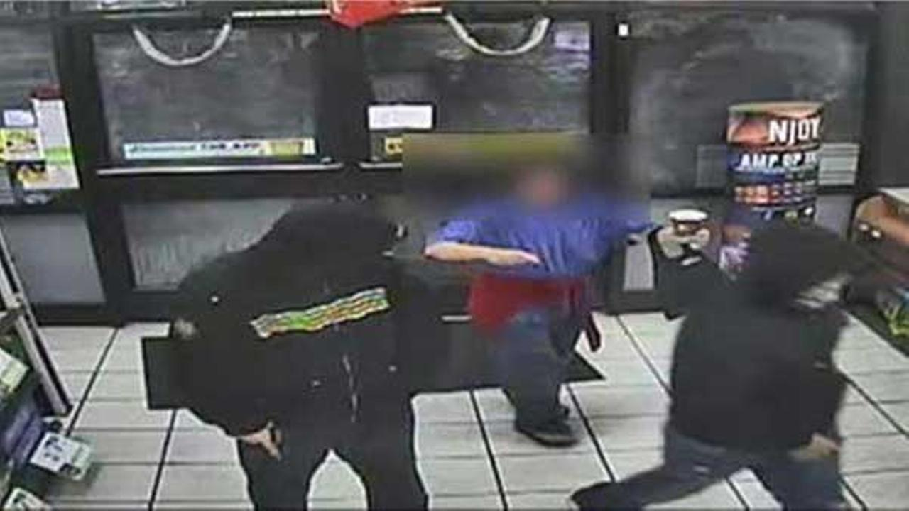 Philadelphia police are looking for 2 gunmen who robbed a 7-Eleven in Wissinoming.