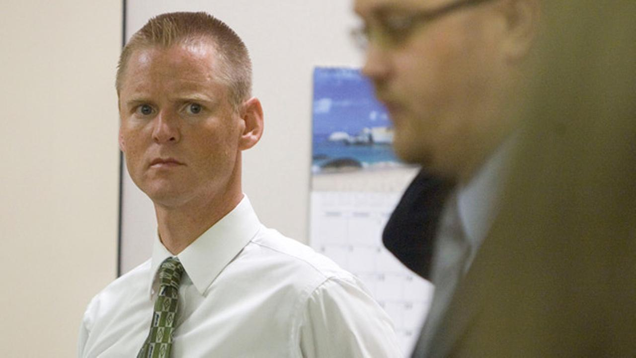 Super Dell Buck Schanze, left, listens to his attorney Harold Stone at the beginning of his criminal case Monday, June 7, 2010 at Fourth District Court in Orem, Utah.