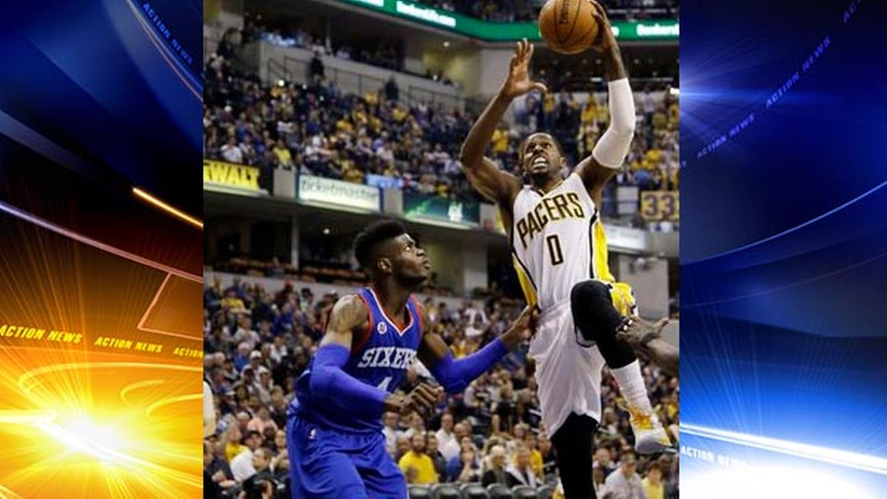 Indiana Pacers guard C.J. Miles (0) shoots over Philadelphia 76ers forward Nerlens Noel (4), Wednesday, Oct. 29, 2014.