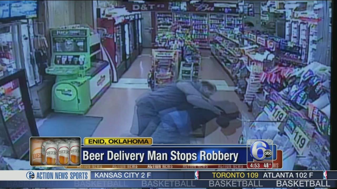 VIDEO: Beer delivery man stops robbery