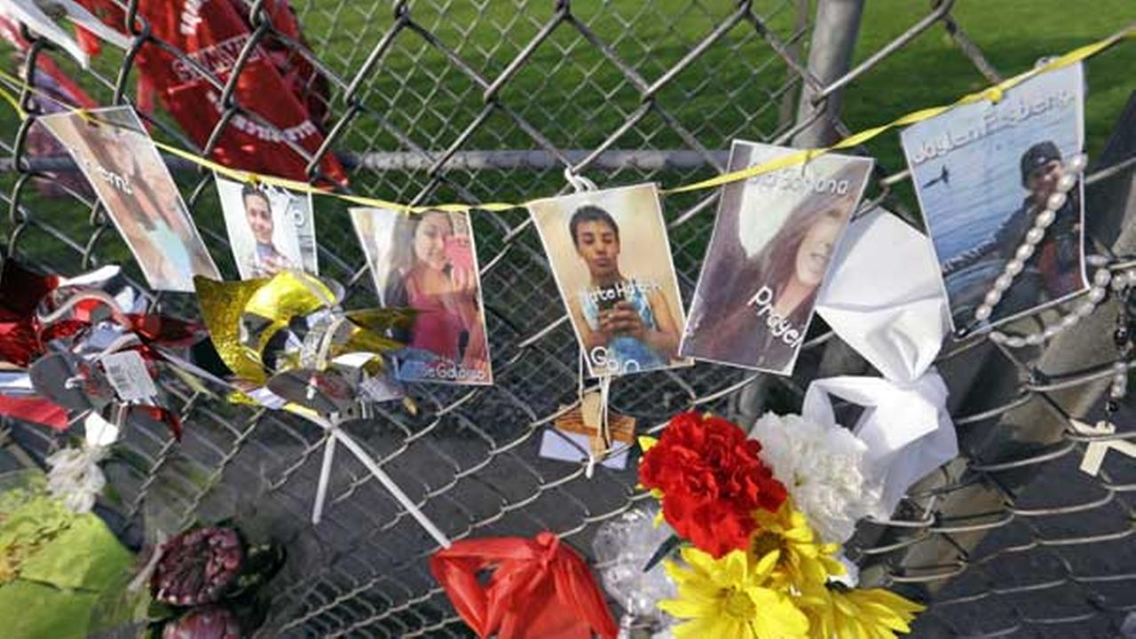 Photos of students shot, and the shooter, are hung together on a fence at Marysville-Pilchuck High School memorializing a shooting there last week, Wednesday, Oct. 29, 2014.