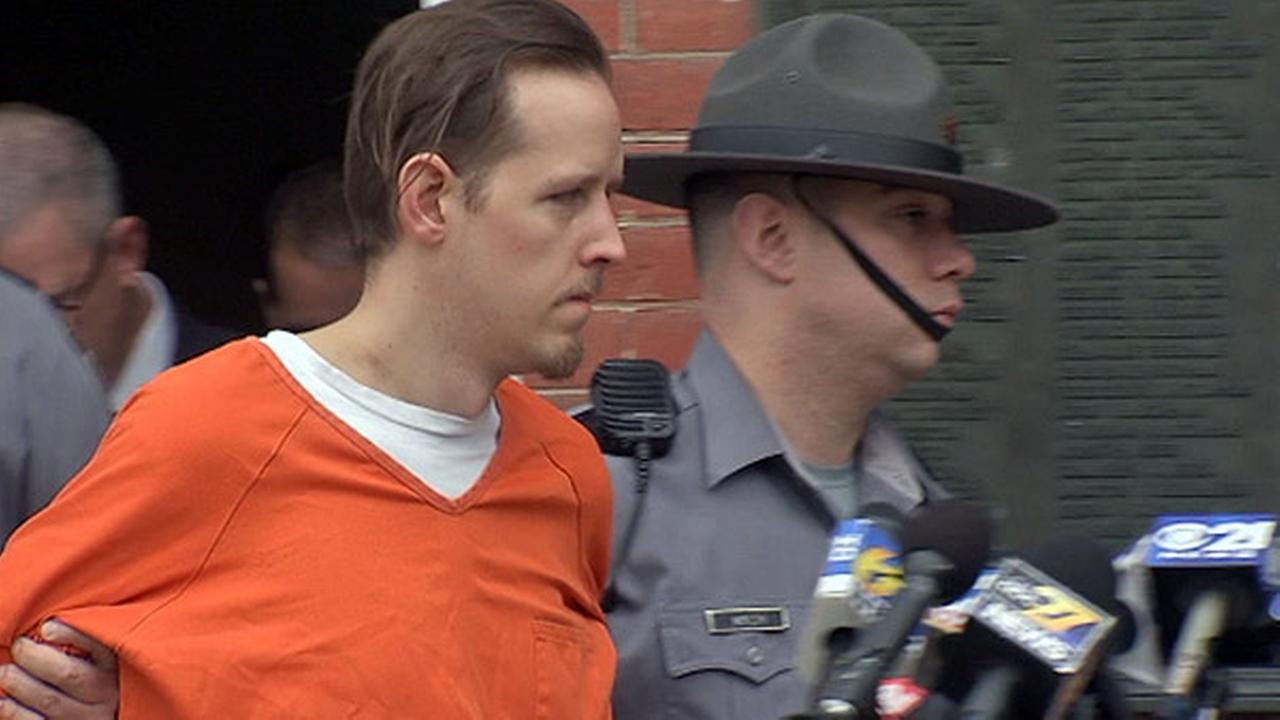 October 31, 2014: Eric Frein is led out of the Pike County Courthouse after being arraigned for the murder of a Pennsylvania state trooper.