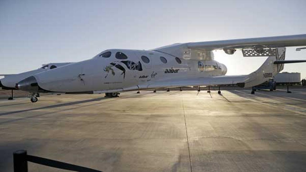 FILE - In this Sept. 25, 2013, file photo, shows Virgin Galactics SpaceShipTwo at a Virgin Galactic hangar at Mojave Air and Space Port in Mojave, Calif.