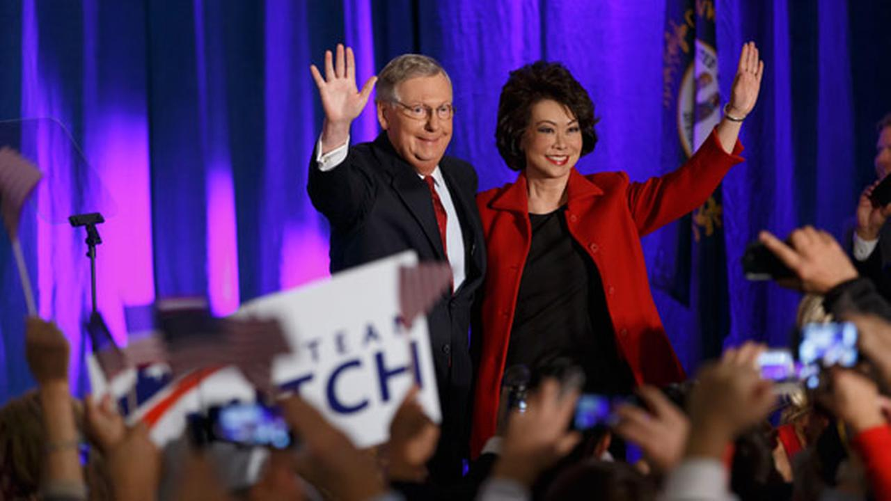 Senate Minority Leader Mitch McConnell of Ky., joined by his wife, former Labor Secretary Elaine Chao, celebrates with his supporters at an election night party in Louisville, Ky.