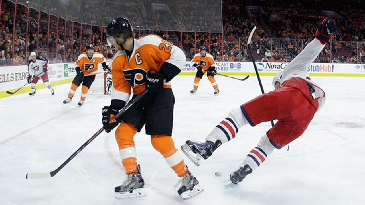 Columbus Blue Jackets Scott Hartnell, right, is sent flying after colliding with Philadelphia Flyers Claude Giroux during the first period of an NHL hockey game.