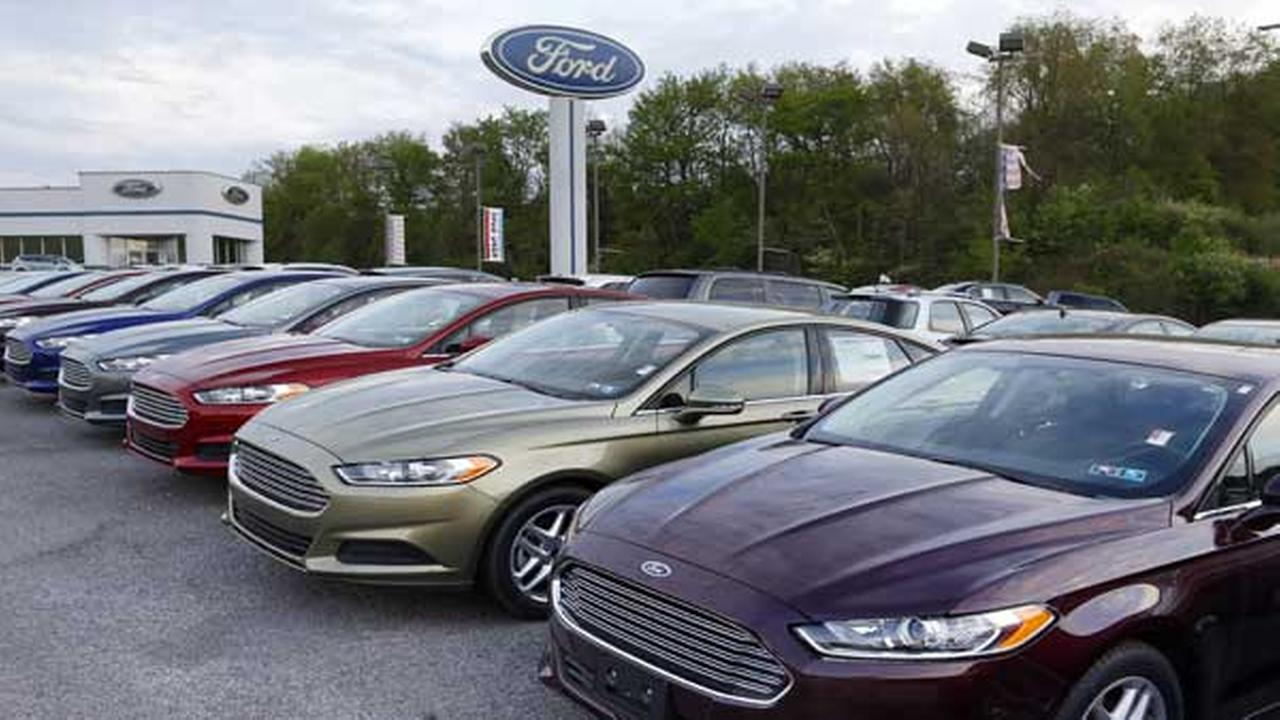 In this Wednesday, May 8, 2013 photo, new 2013 Ford Fusions are seen at an automobile dealer in Zelienople, Pa.