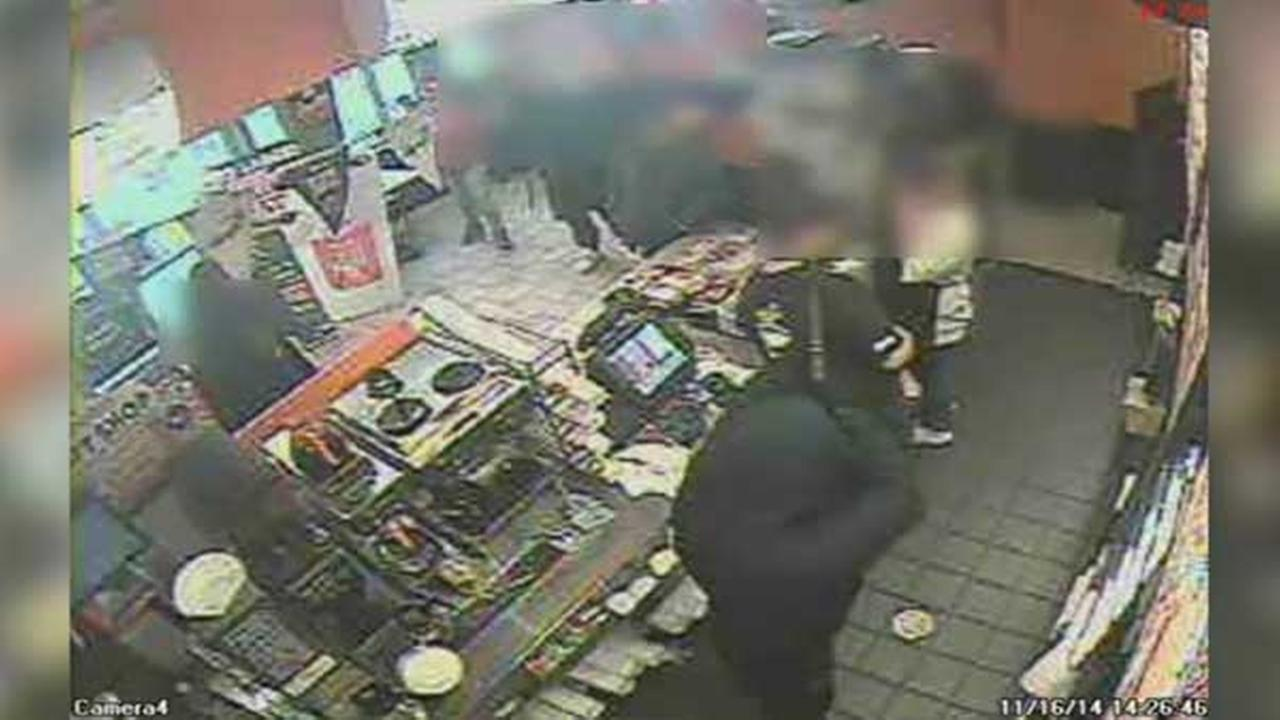 Philadelphia police are looking for two masked gunmen who robbed a Dunkin Donuts in Fishtown.