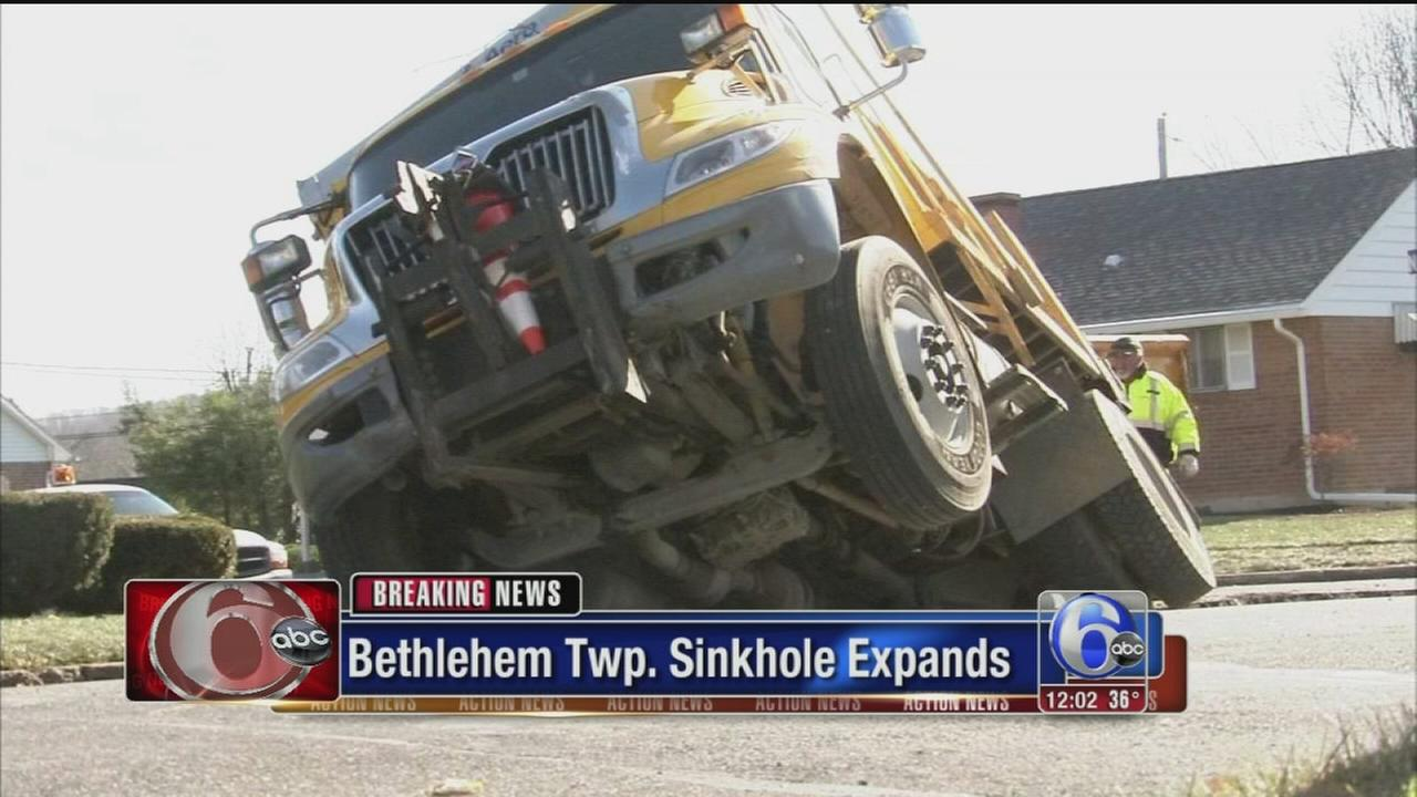 VIDEO: 2nd truck topples into expanding sinkhole