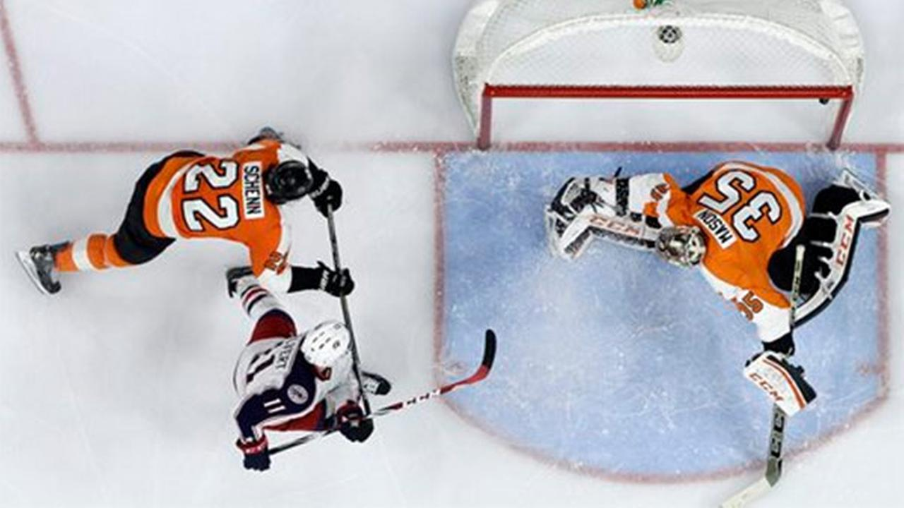 Columbus Blue Jackets Matt Calvert (11) scores a goal past Philadelphia Flyers Steve Mason (35) and Luke Schenn (22), Saturday, Nov. 22, 2014, in Philadelphia.