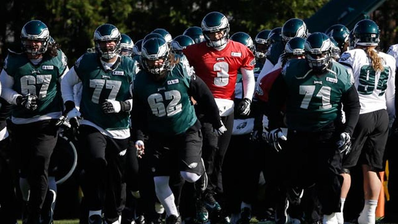 Philadelphia Eagles Mark Sanchez (3) and teammates move to their next drill during NFL football practice at the teams training facility, Tuesday, Nov. 18, 2014, in Philadelphia.