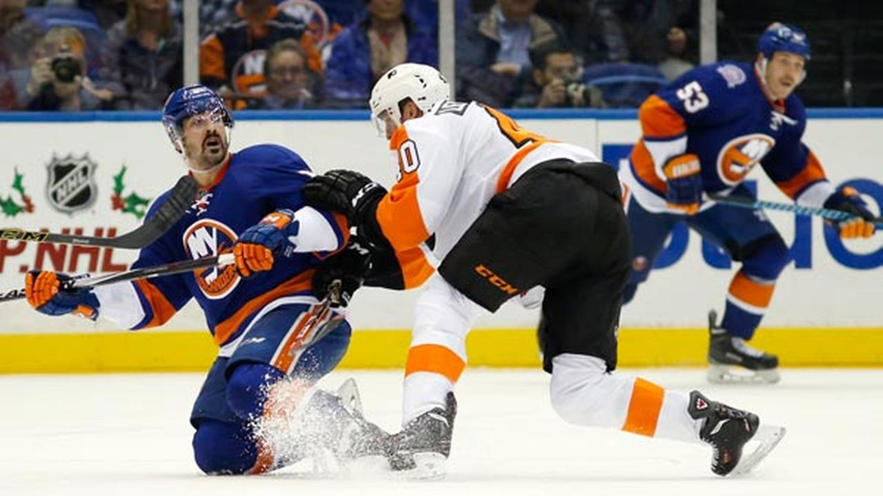 Philadelphia Flyers center Vincent Lecavalier (40) checks New York Islanders right wing Cal Clutterbuck (15) in the third period.