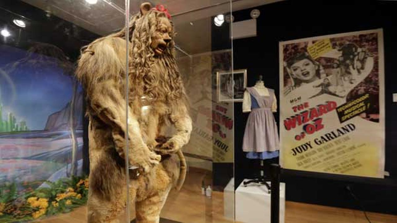 This Nov. 21, 2014 photo shows Bert Lahrs Cowardly Lion costume and a three-sheet poster from The Wizard of Oz.