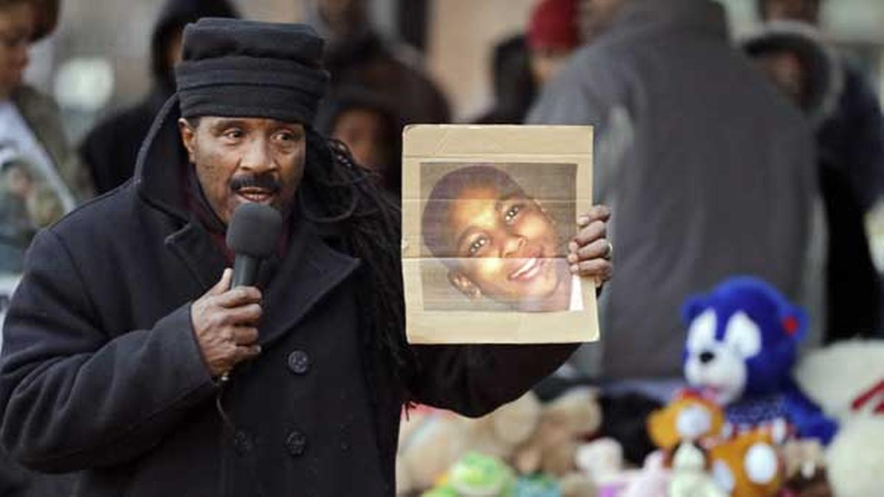 Activist Art McCoy holds a photo of Tamir Rice before a protest march at Cudell Park in Cleveland, Monday, Nov. 24, 2014.