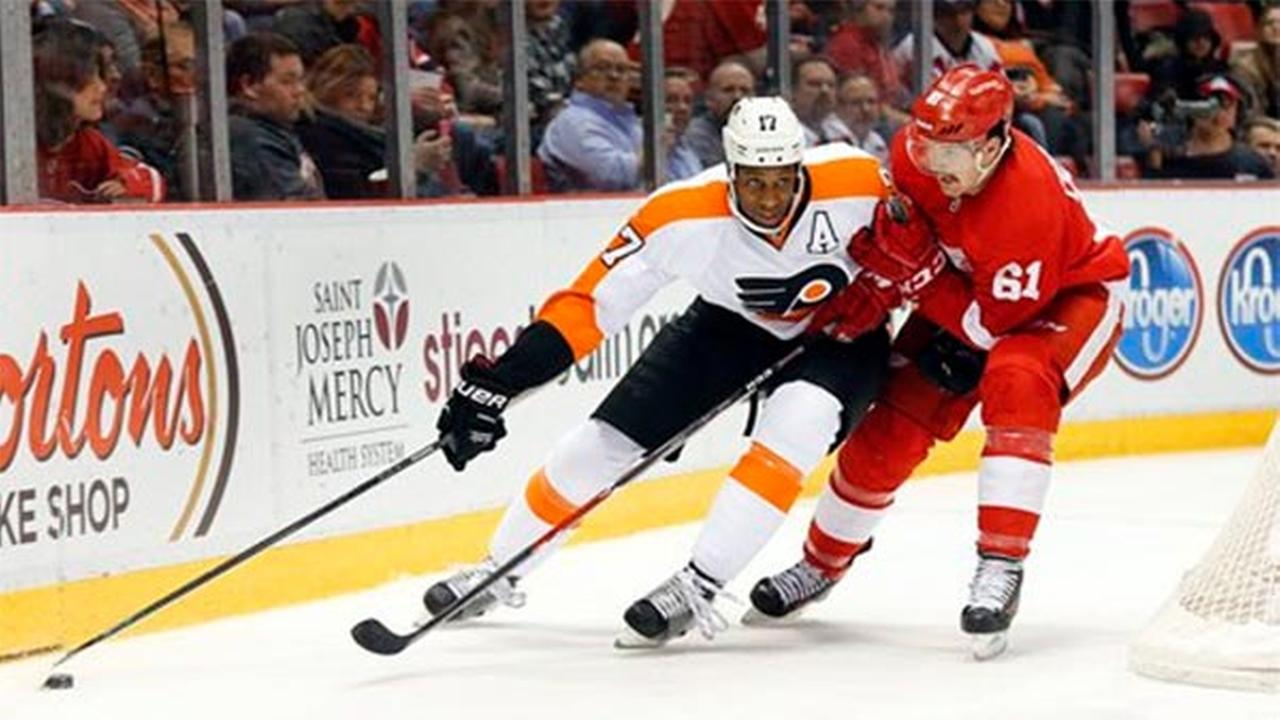 Detroit Red Wings defenseman Xavier Ouellet (61) defends Philadelphia Flyers right wing Wayne Simmonds (17), Wednesday, Nov. 26, 2014.