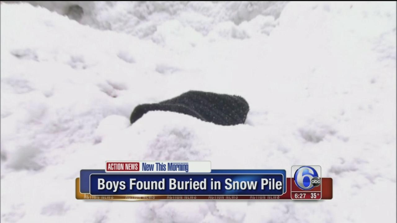 VIDEO: Boys found buried in snow pile