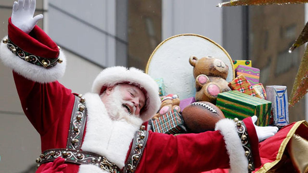 Santa Claus waves at the crowd during the Macys Thanksgiving Day Parade, Thursday, Nov. 27, 2014, in New York.