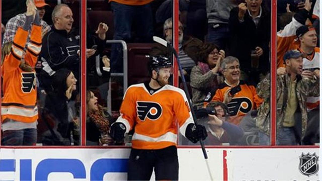 Philadelphia Flyers Sean Couturier celebrates after scoring a goal during the first period against the New Jersey Devils, Thursday, Dec. 11, 2014.