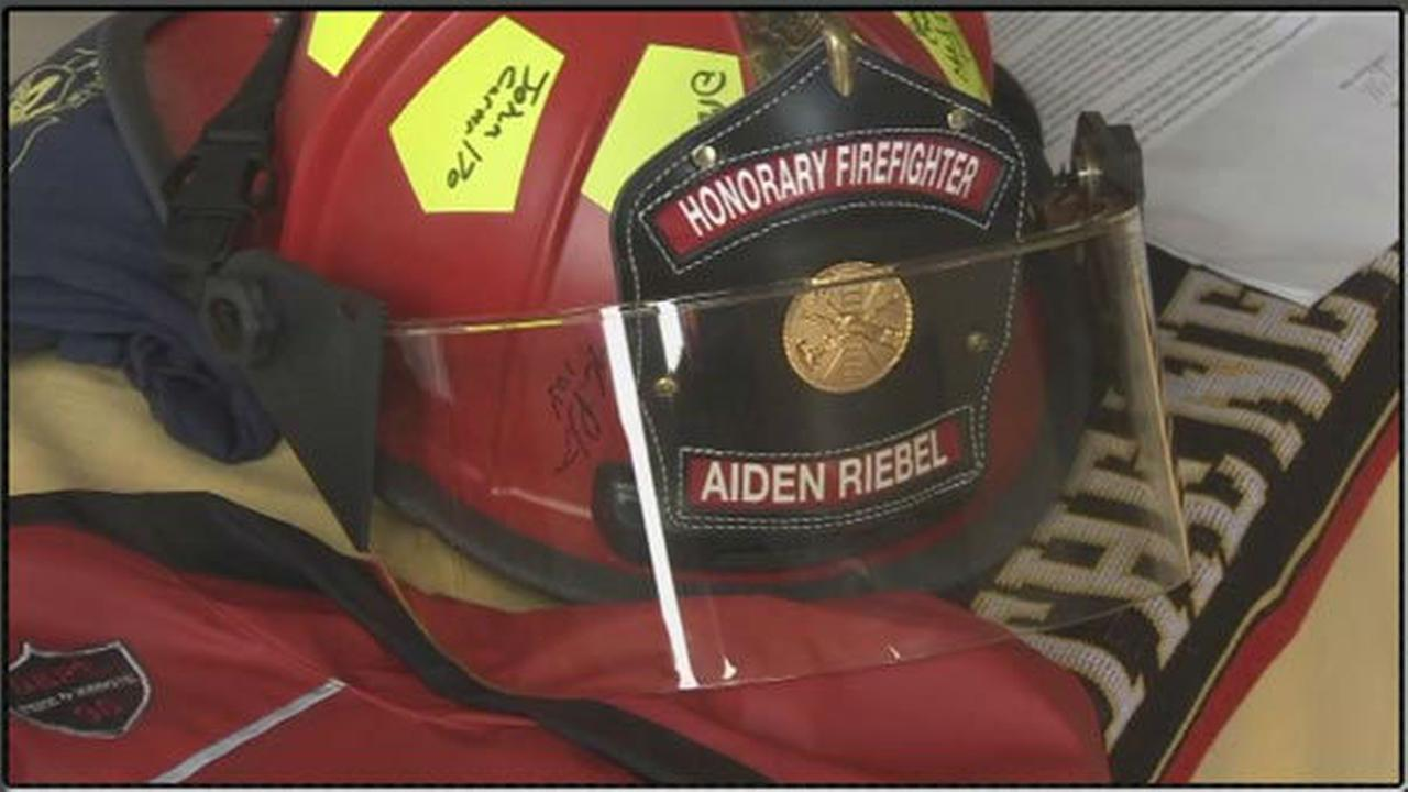 PHOTOS: Boy, 7, laid to rest as firefighter