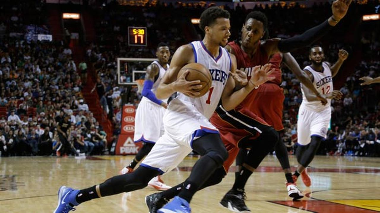 Philadelphia 76ers guard Michael Carter-Williams (1) drives to the basket as Miami Heat guard Mario Chalmers, right, defends.
