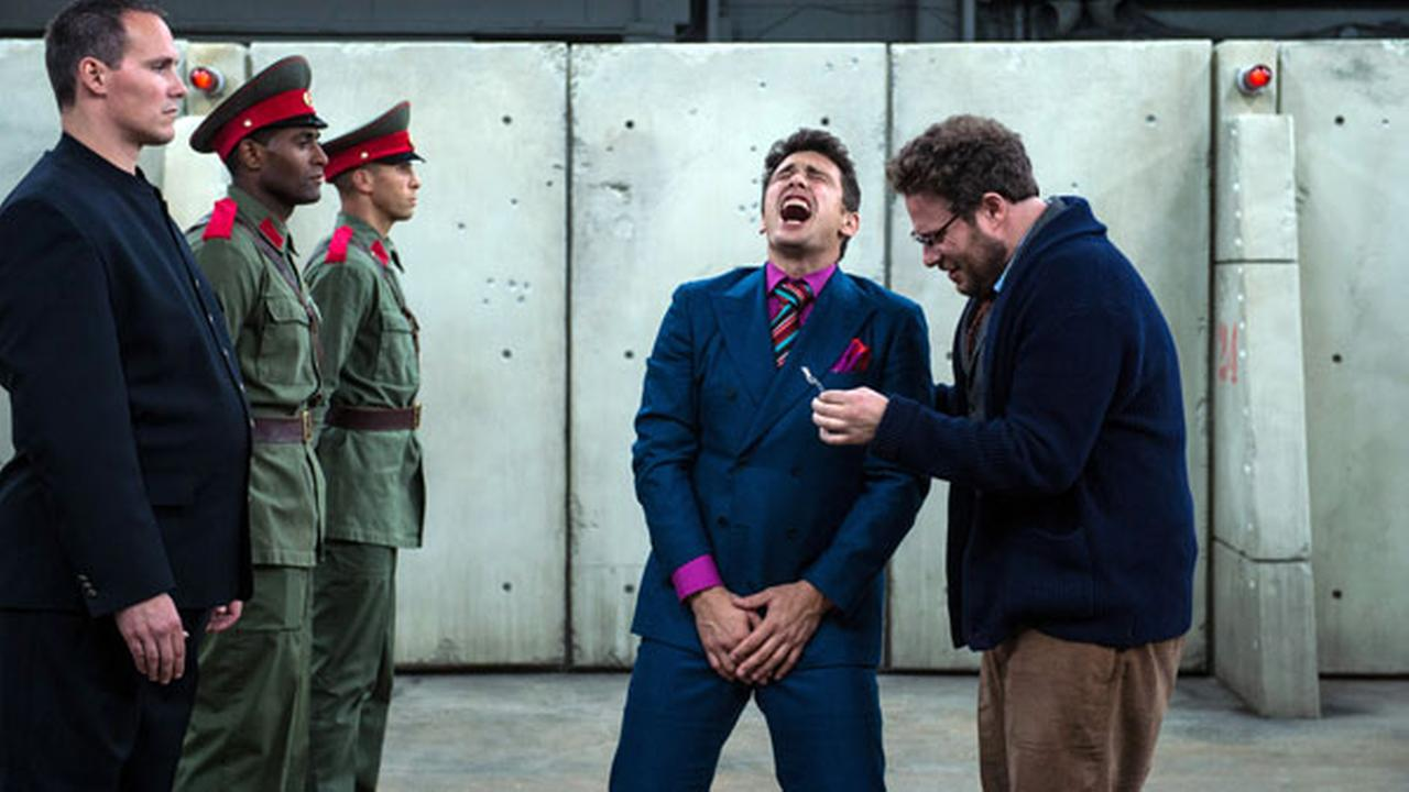 This photo provided by Columbia Pictures - Sony shows, James Franco, center, as Dave, and Seth Rogen, right, as Aaron, in Columbia Pictures The Interview.