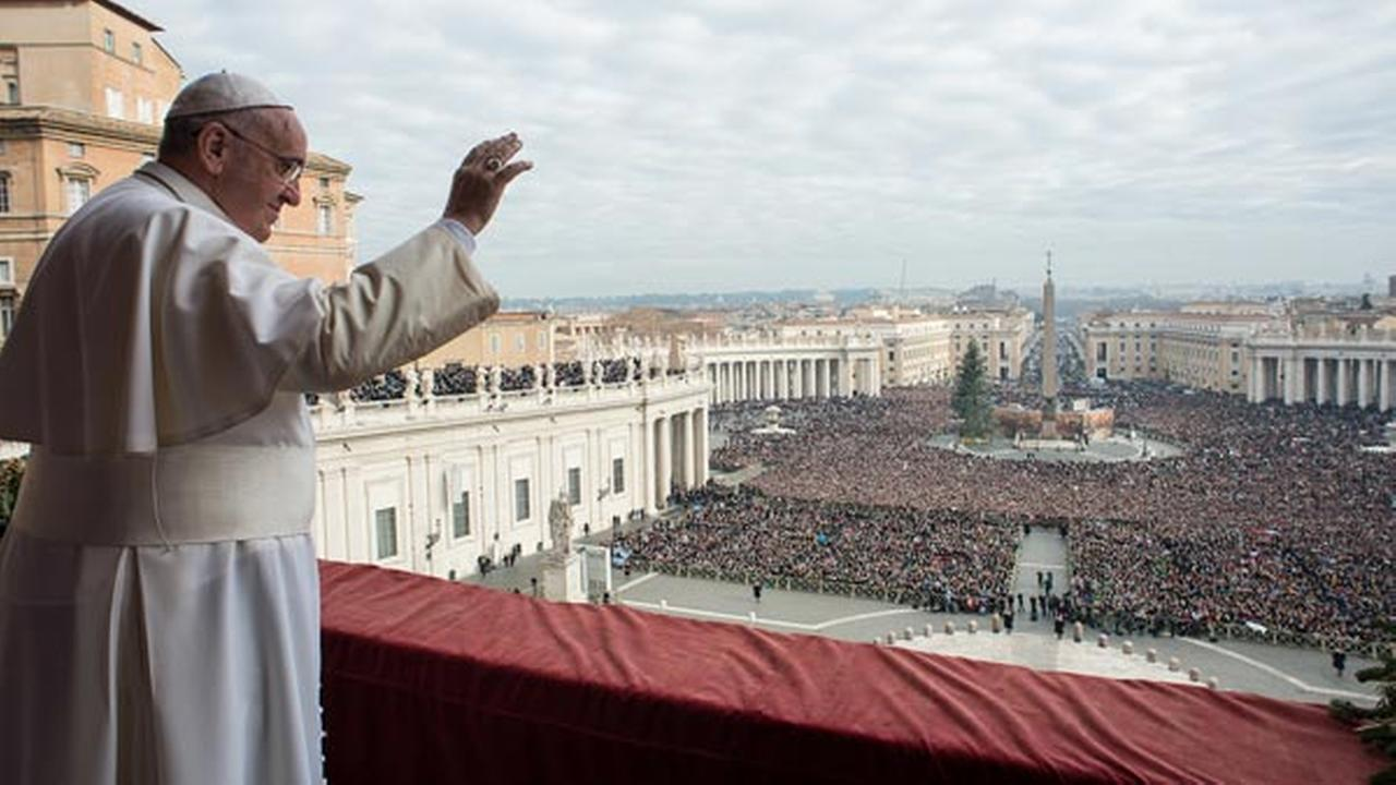 In this picture provided by the Vatican newspaper LOsservatore Romano, Pope Francis delivers his Urbi et Orbi blessing from the central balcony of St. Peters Basilica.