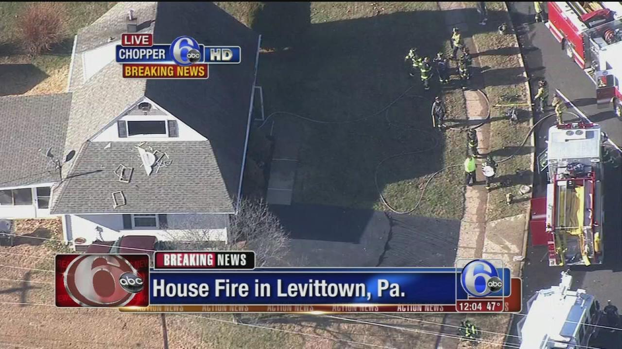 VIDEO: Firefighters battle house blaze in Levittown, Pa.