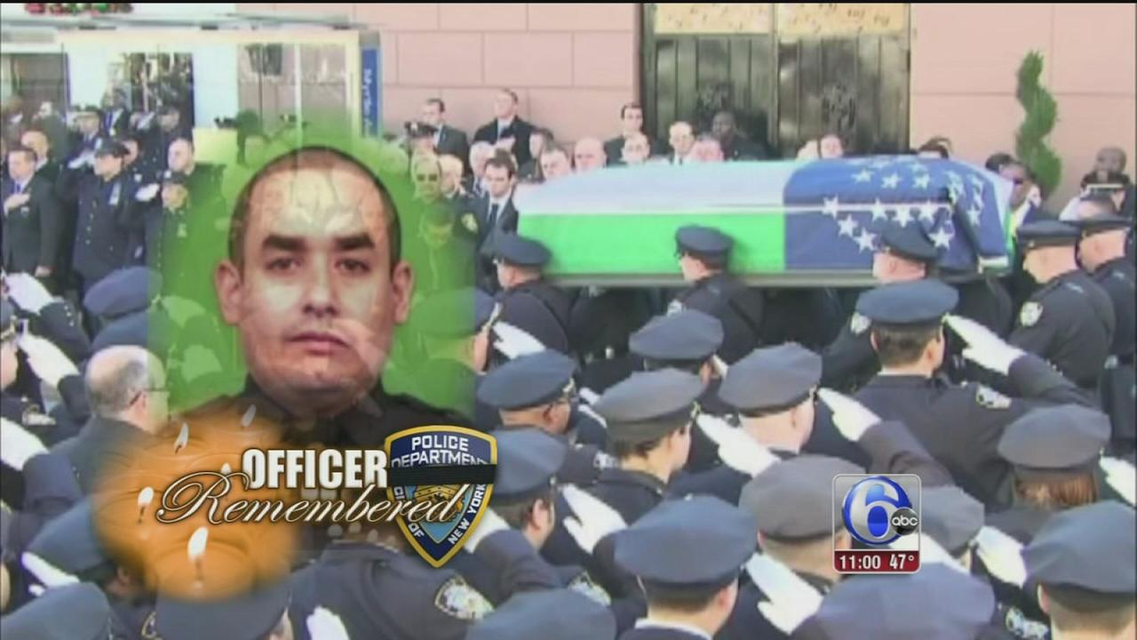 VIDEO: NYC officer mourned at funeral as tensions linger