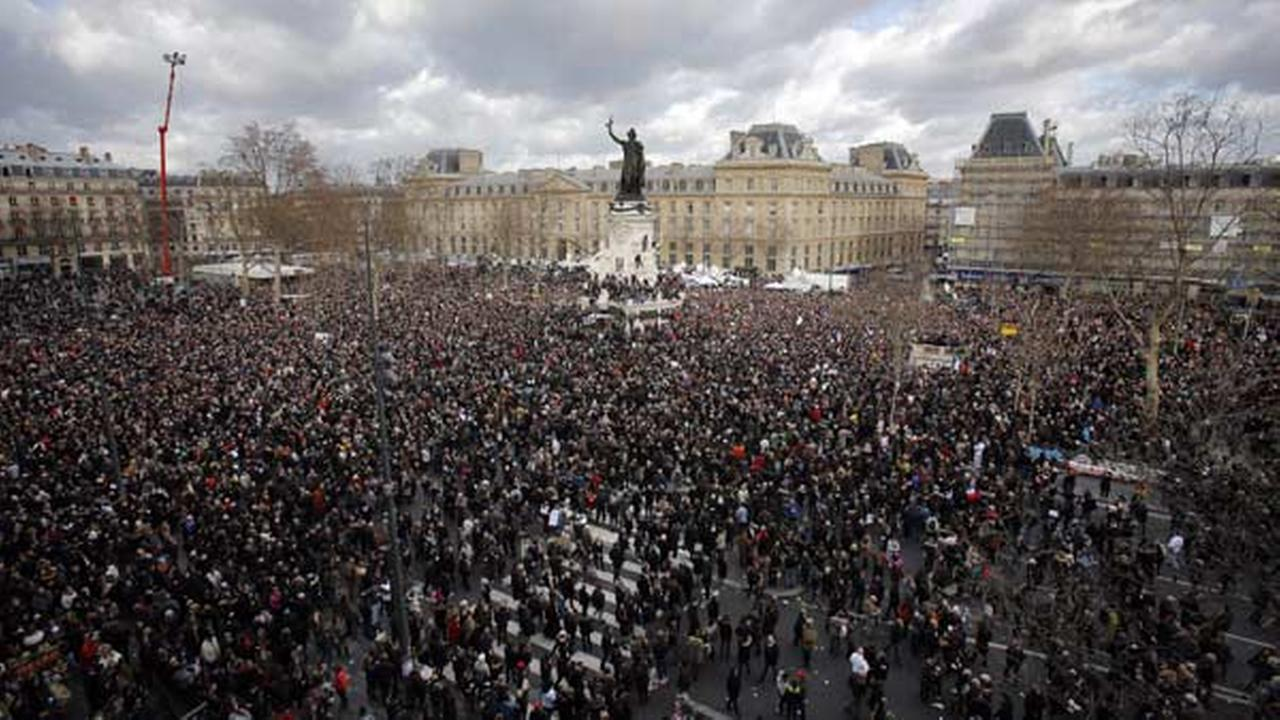A crowd gather in Republique square before the demonstration, in Paris, France, Sunday, Jan. 11, 2015.