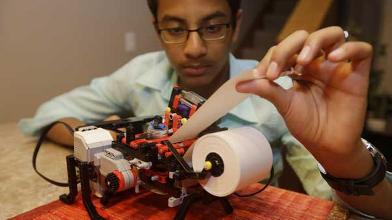 Shubham Banerjee works on his lego robotics braille printer at home Tuesday, Jan. 6, 2015, in Santa Clara, Calif.